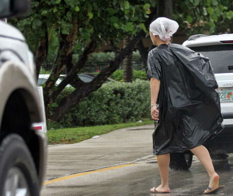 An unidentified woman dressed in bags crosses Seabreeze Blvd. on Ft. Lauderdale Beach, Florida, Friday, October 26, 2012, as Hurricane Sandy passes to the east. (Amy Beth Bennett/Sun Sentinel/MCT) Photo: Amy Beth Bennett, McClatchy-Tribune News Service / ARCHIVE