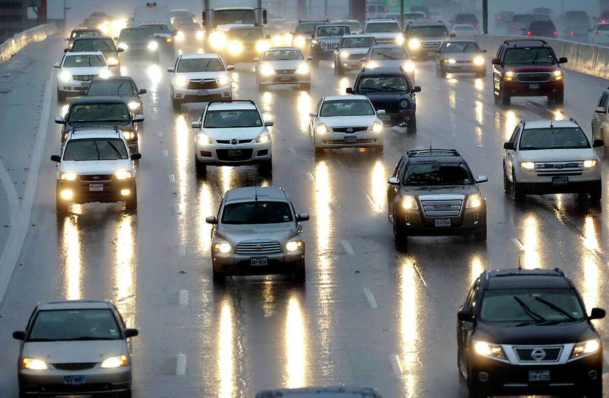 Traffic streaks across a rain soaked I-410 at Blanco Rd. Thursday, Jan. 22, 2015.