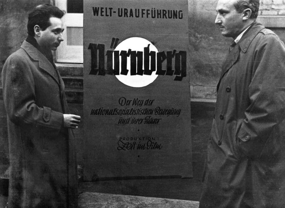 Writer-director Stuart Schulberg (left) at Nuremberg?s 1948 premiere in Stuttgart, Germany, with OMGUS film officer John Scott (right). (Schulberg Family Archive)