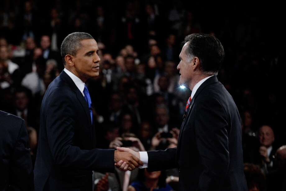 BOCA RATON, FL - OCTOBER 22:  U.S. President Barack Obama (L) shakes hands with Republican presidential candidate Mitt Romney after the debate at the Keith C. and Elaine Johnson Wold Performing Arts Center at Lynn University on October 22, 2012 in Boca Raton, Florida. The focus for the final presidential debate before Election Day on November 6 is foreign policy.  (Photo by Michael Reynolds-Pool/Getty Images) Photo: Pool, Getty Images / 2012 Getty Images