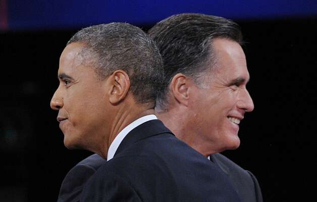 US President Barack Obama greets Republican Presidential candidate Mitt Romney at the end of the third and final presidential debate at Lynn University in Boca Raton, Florida, October 22, 2012. The showdown focusing on foreign policy is being held in the crucial toss-up state of Florida just 15 days before the election and promises to be among the most watched 90 minutes of the entire 2012 campaign. AFP PHOTO / Saul LOEBSAUL LOEB/AFP/Getty Images Photo: SAUL LOEB, AFP/Getty Images / AFP
