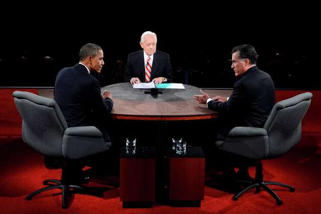 Moderator Bob Schieffer listens to US President  Barack Obama and Republican presidential candidate Mitt Romney during the third presidential debate on October 22, 2012 at Lynn University in Boca Raton, Florida. Obama and Romney battled over foreign policy in their last debate of a White House race that is deadlocked with two weeks to go. The rivals faced a final chance to land a decisive blow in front of millions of television viewers, before a last-ditch dash for votes in a bitter campaign that has exposed the sharp political divide splitting America in two. AFP PHOTO /  MICHAEL REYNOLDS -POOLMICHAEL REYNOLDS/AFP/Getty Images Photo: MICHAEL REYNOLDS, AFP/Getty Images / AFP