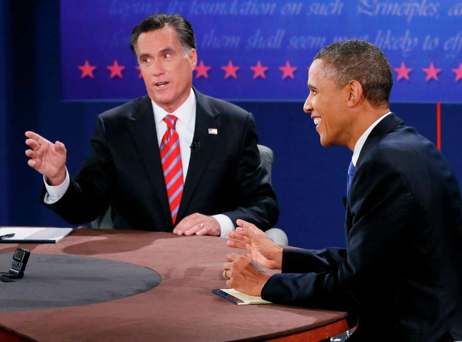 President Barack Obama smiles as Republican presidential nominee Mitt Romney speaks during the third presidential debate at Lynn University, Monday, Oct. 22, 2012, in Boca Raton, Fla. (AP Photo/Pool-Rick Wilking) Photo: Rick Wilking, Associated Press / Reuters Pool