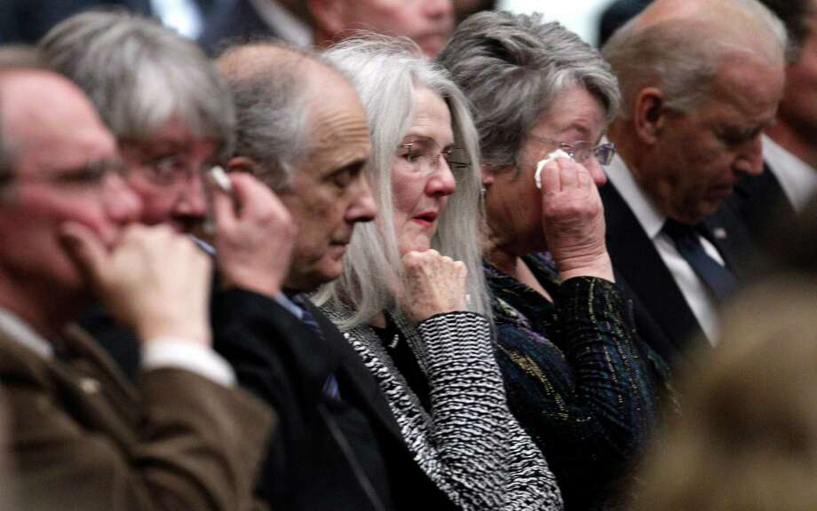 The daughters of former Democratic U.S. senator and three-time presidential candidate George McGovern Susan Rowen, left, and Ann McGovern listen along with Vice President Joe Biden, right, during a prayer service at the First United Methodist Church in Sioux Falls, S.D., Thursday. Photo: M. Spencer Green, Associated Press / AP POOL