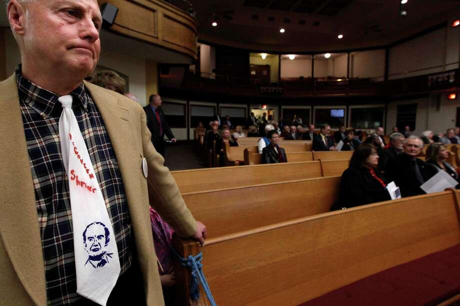 Greg Melville, of Cheshire, Conn. wears a McGovern Shriver tie from the 1972 Presidential campaign at the prayer service. Photo: M. Spencer Green, Associated Press / AP POOL