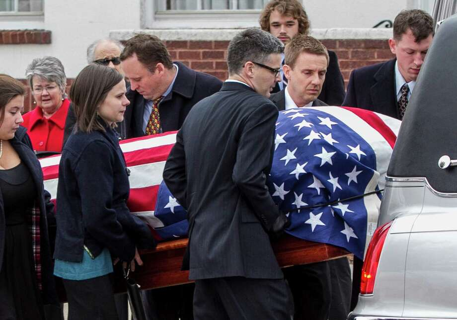 Family members place the casket of former Democratic U.S. Senator and three-time presidential candidate George McGovern onto a hearse as it is being transported to the Washington Pavilion of Arts and Science in Sioux Falls, S.D., for the funeral Friday. Photo: Nati Harnik, Associated Press / AP