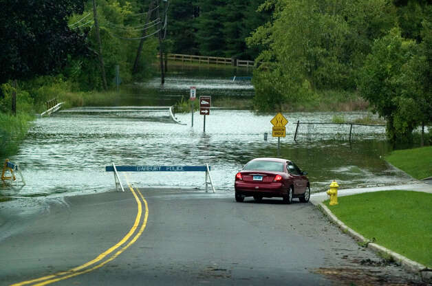 Kenosia Avenue in Danbury was closed due to the swellilng of Lake Kenosia due to Hurricane Irene on Sunday, Aug. 28, 2011. Photo: Jason Rearick