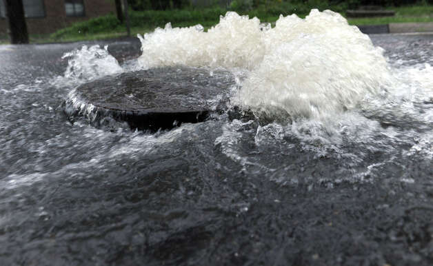 Rain water from Hurricane Irene streams down Lake Avenue in Danbury Sunday morning. Photo taken August 28, 2011. Photo: Carol Kaliff