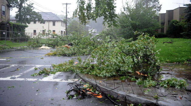 Winds and rain from Hurricane Irene brought down tree branches off Main Street in Danbury Sunday morning. Photo taken Sunday, Aug. 28, 2011. Photo: Carol Kaliff