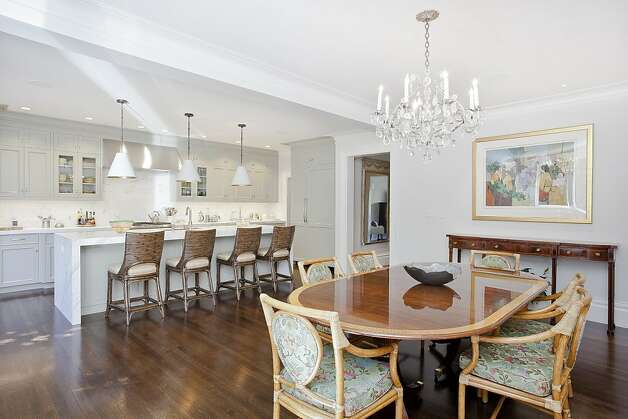 The great room mixes a modern feel with classical elements. Photo: OpenHomesPhotography.com