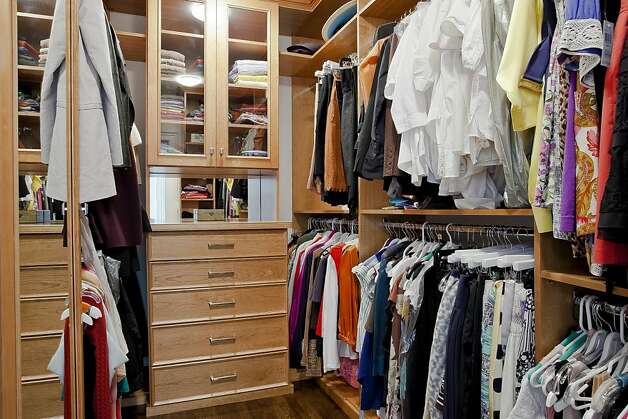The master bedroom has a large walk-in closet. Photo: OpenHomesPhotography.com