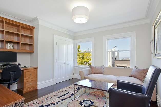This room offers exquisite views of the city. Photo: OpenHomesPhotography.com