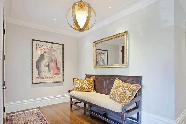 The house has wooden floors and crown molding. Photo: OpenHomesPhotography.com