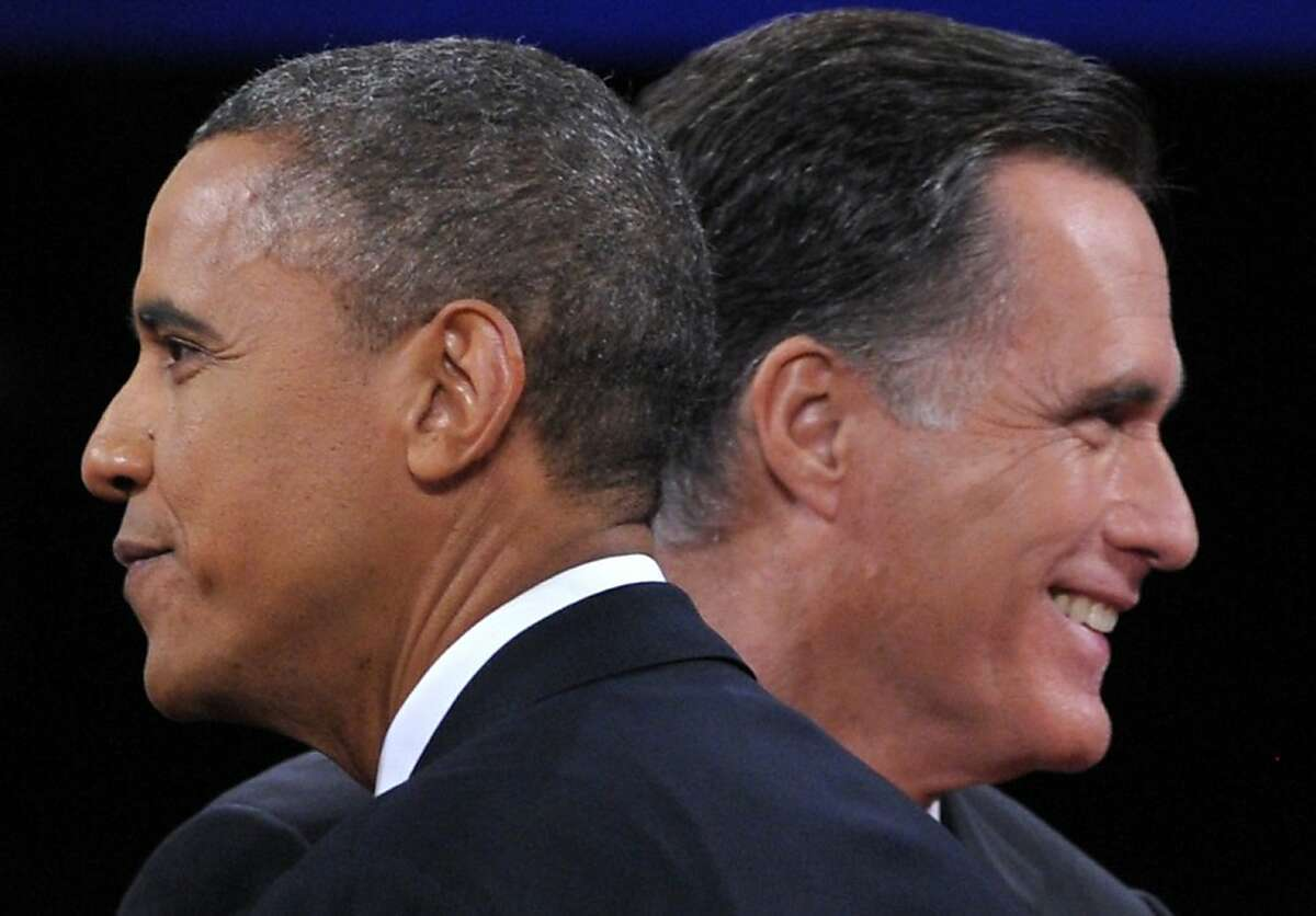 TOPSHOTS US President Barack Obama (L) greets Republican presidential candidate Mitt Romney (R) following the third and final presidential debate at Lynn University in Boca Raton, Florida, October 22, 2012. The showdown focusing on foreign policy is being held in the crucial toss-up state of Florida just 15 days before the election and promises to be among the most watched 90 minutes of the entire 2012 campaign. AFP PHOTO / Saul LOEBSAUL LOEB/AFP/Getty Images