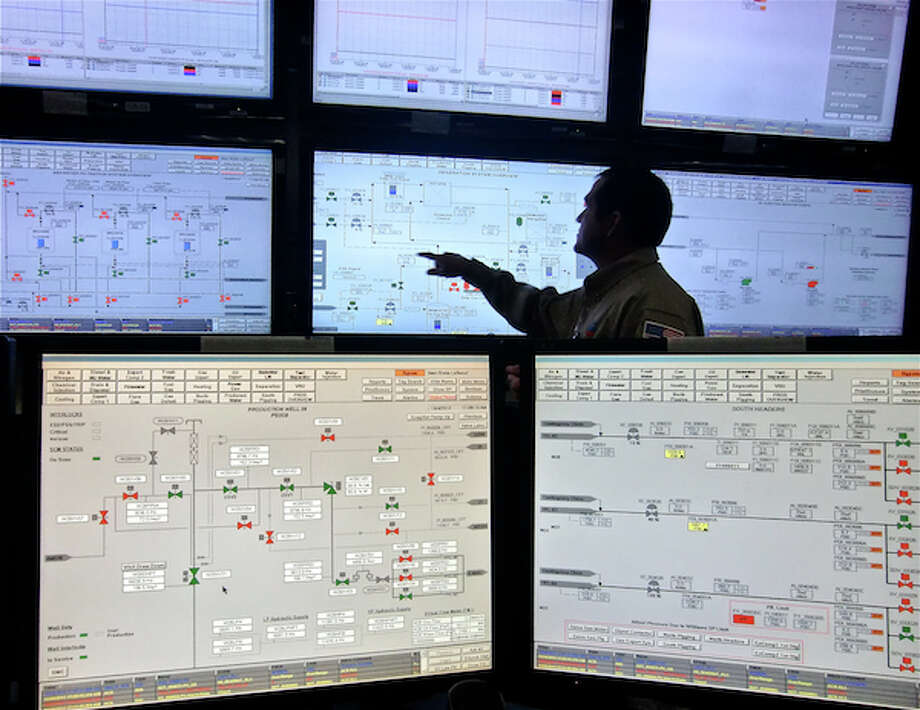 The control room on Chevron's Tahiti platform is manned 24 hours. More than two dozen screens fill the room, displaying surveillance videos and the flow of oil from the well through the production equipment. (Simone Sebastian/Houston Chronicle) (Simone Sebastian/Houston Chronicle)