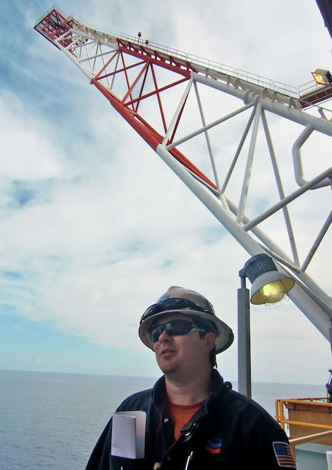 The flare of Chevron's Tahiti platform rises over the Gulf of Mexico, more than 100 miles offshore. (Simone Sebastian/Houston Chronicle)