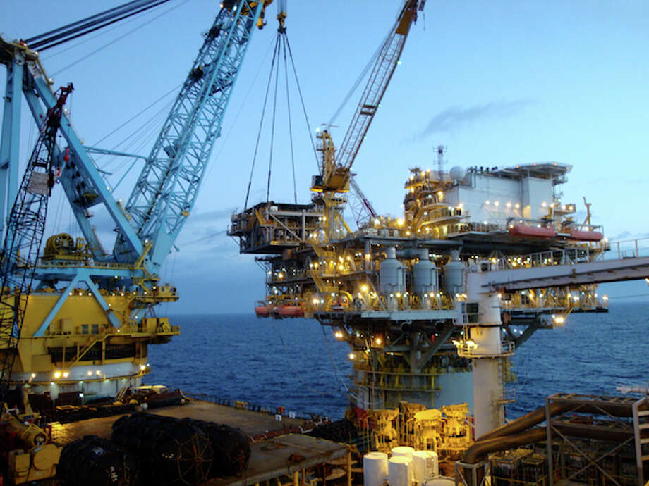 A 1,250-ton water injection module is lifted onto Chevron's Tahiti platform in November 2011. Water injection is expected to extend the project's life by about 10 years. (Ade Ariyo/Chevron)