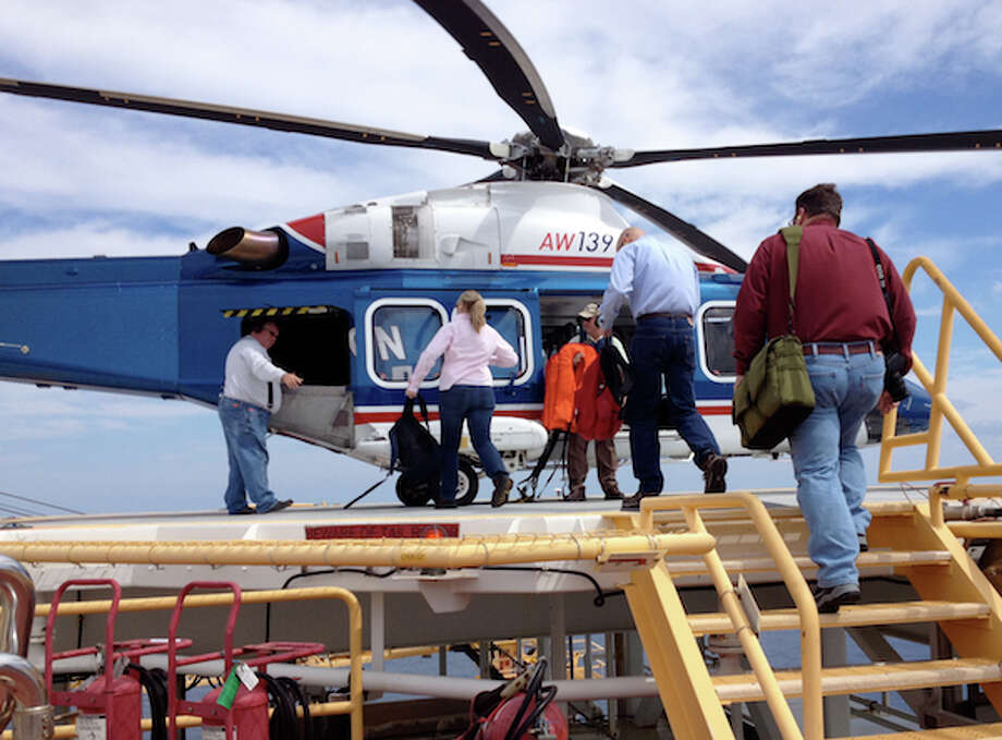 Chevron employees board a helicopter on the Tahiti production platform in the Gulf of Mexico, a 90 minute ride from New Orleans. (Simone Sebastian/Houston Chronicle)