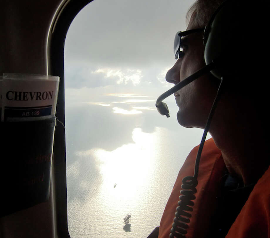 Kevin Ricketts, a project manager for Chevron, flies over the Gulf of Mexico on a trip to the Tahiti field. (Simone Sebastian/Houston Chronicle)