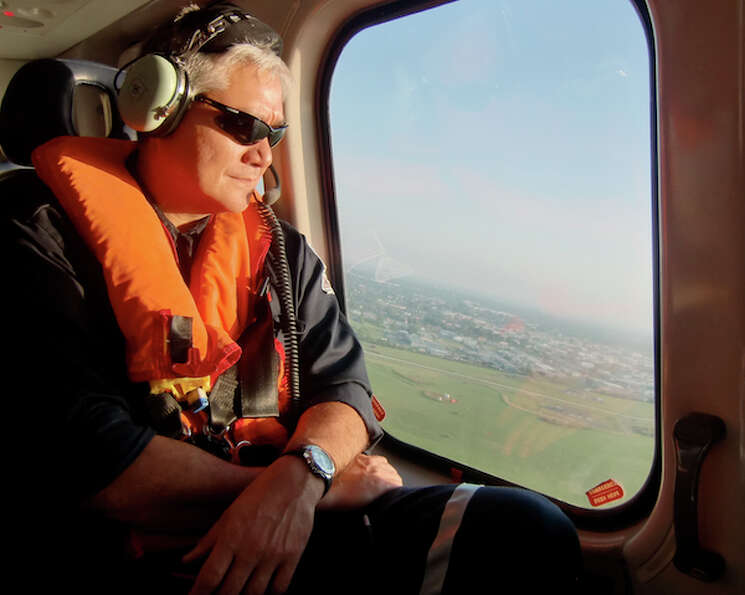 Rick Bullock, Chevron's deepwater operations manager, rides in a company helicopter from New Orleans
