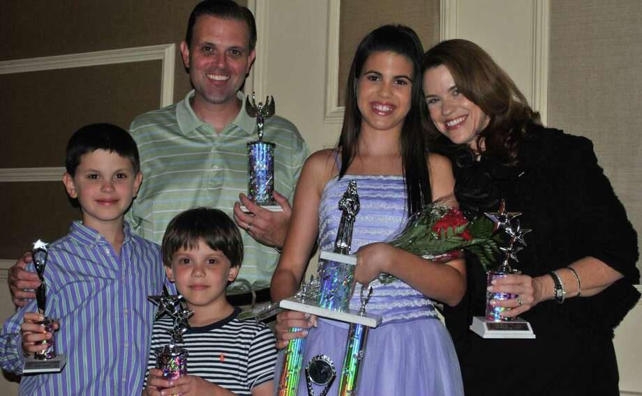 Grace Rodi (second from right) and her family with the trophies she won at her first pageant, the National American Miss Connecticut Pre-Teen 2012. Photo: Contributed
