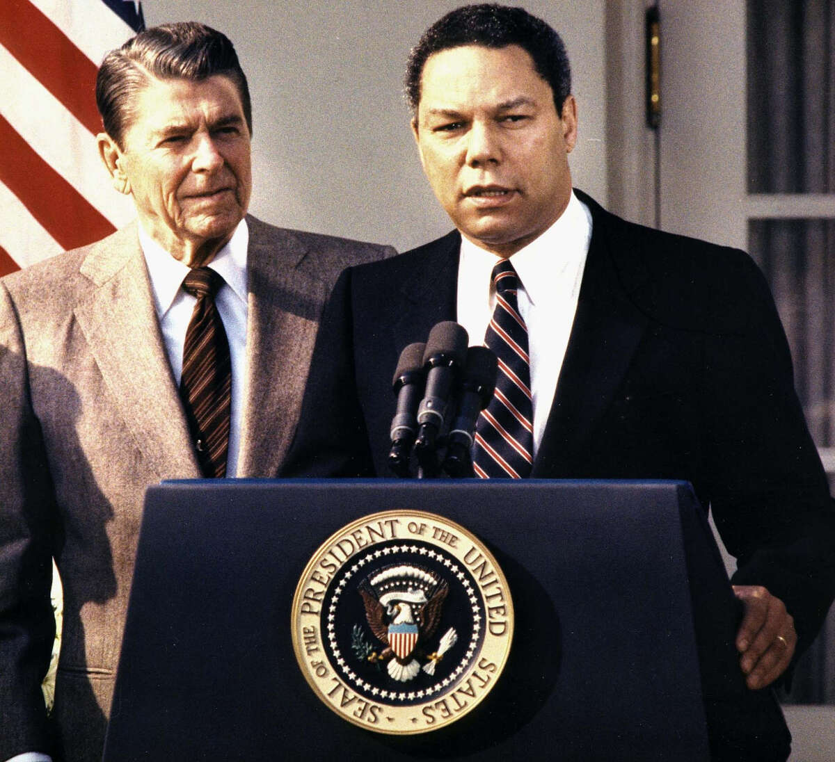 Then Lt. General Colin Powell stands with then President Ronald Reagan in 1987. Powell was the highest ranking African-American in the Reagan administration at the time. (Photo by CHRIS WILKINS/AFP/Getty Images)