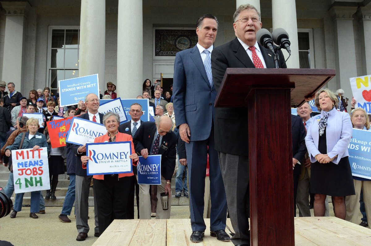 Former Massachusetts Gov. Mitt Romney listens as ex-New Hampshire Governor John Sununu endorses him on Oct. 24, 2011. (Photo by Darren McCollester/Getty Images)