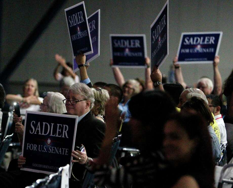 U.S. Senate Candidate Paul Sadler supporters hold signs up during the the 2012 Texas Democratic Party State Convention at the George R. Brown Convention Center Friday, June 8, 2012, in Houston. Photo: James Nielsen, Chronicle / © Houston Chronicle 2012