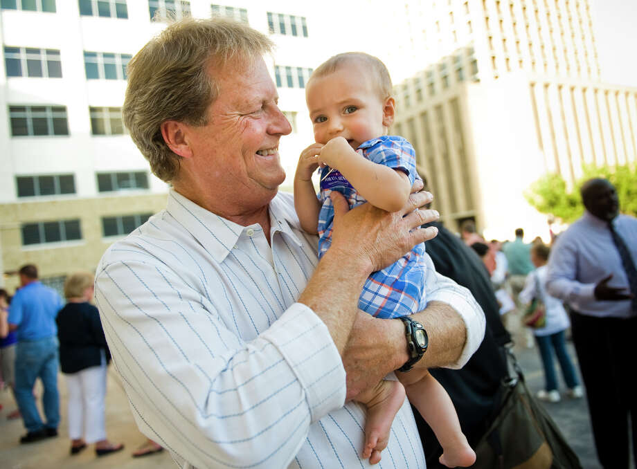 U.S. Senate candidate Paul Sadler (D) holds 10-month-old Pablo Hinojosa-Donisi, son of Austin ISD school board candidate Gina Hinojosa, during a fish fry at the American Federation of Labor - Congress of Industrial Organizations in Austin, TX on Fri., Aug. 31, 2012. Photo: Ashley Landis / copyright 2012 Ashley Landis