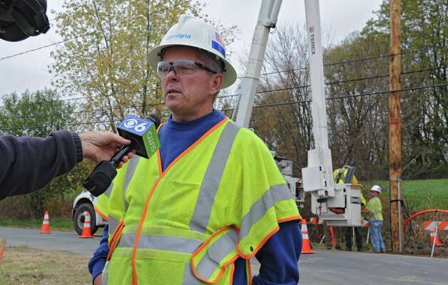 National Grid supervisor Jim Kelly answers questions at a work scene where media inquired about preparations for Hurricane Sandy on Friday, Oct. 26, 2012 in Loudonville, N.Y. (Lori Van Buren / Times Union) Photo: Lori Van Buren