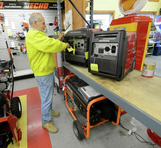 "Frank Esposito checks the stock of generators at his store in Menands, N.Y. Oct 26, 2012 in preparation for the possible arrival of hurricane or tropical storm ""Sandy"".  Esposito said that he had sold for generators before noon today.     (Skip Dickstein/Times Union) Photo: Skip Dickstein"