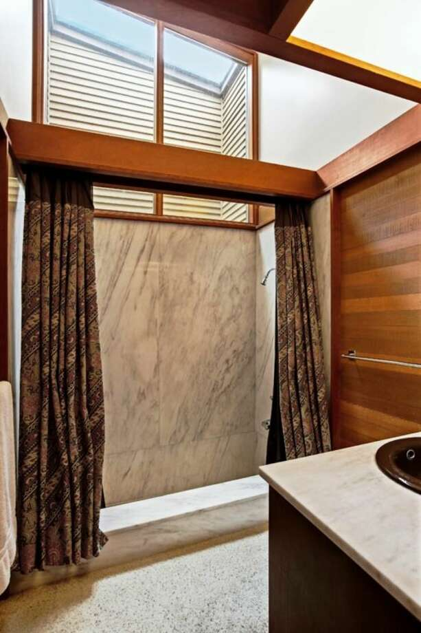Master bathroom, with sunken marble tub, of 4343 W. McLaren St. The 3,540-square-foot house, built in 1968, has four bedrooms and three bathrooms, walls of windows, exposed wood walls and moldings, loft spaces, a den, two furnaces, air conditioning, two patios, a pool and a two-car garage on a 17,000-square-foot lot. It's listed for $979,000. Photo: Courtesy Joan And Doug Gehrke/Windermere Real Estate
