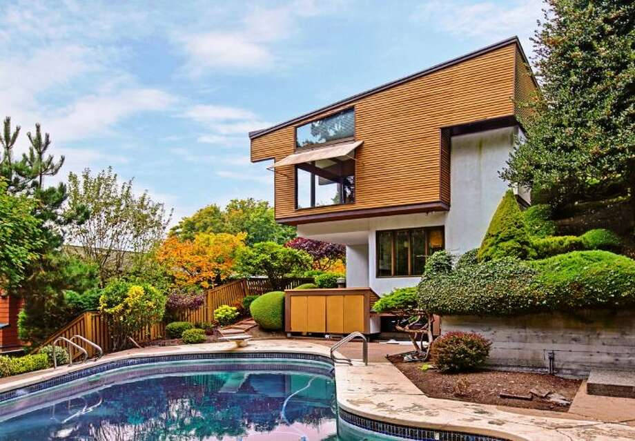 Here's a unique modern home in Magnolia, 4343 W. McLaren St. The 3,540-square-foot house, built in 1968, has four bedrooms and three bathrooms -- including a master suite with a fireplace and sunken marble tub -- walls of windows, exposed wood walls and moldings, loft spaces, a den, two furnaces, air conditioning, two patios, a pool and a two-car garage on a 17,000-square-foot lot. It's listed for $979,000. Photo: Courtesy Joan And Doug Gehrke/Windermere Real Estate