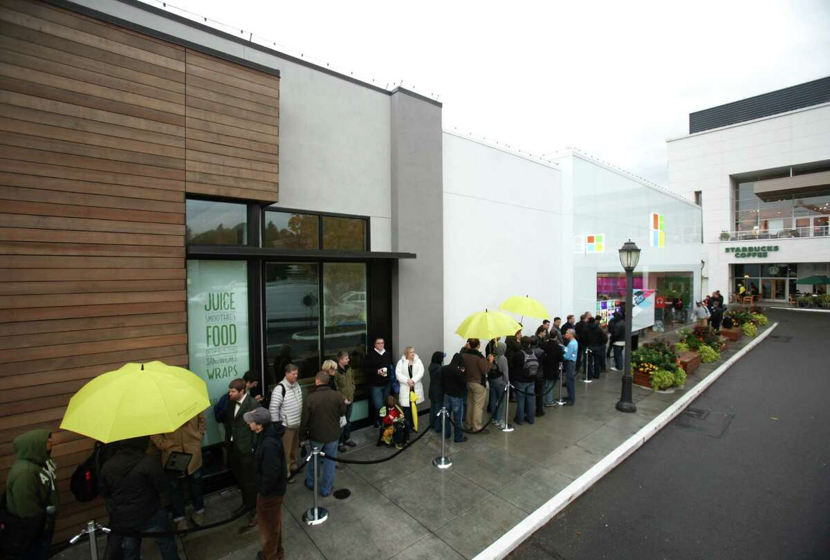 People wait in line as Microsoft's new Surface tablet computer is released on Friday, October 26, 2012 at the University Village Microsoft Store in Seattle.