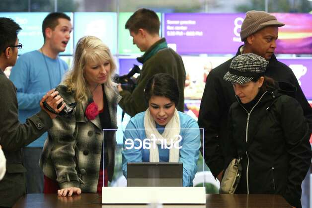Gloribel Mondragon give a demo of a new Surface as Microsoft's new Surface tablet computer is released on Friday, October 26, 2012 at the University Village Microsoft Store in Seattle. Photo: JOSHUA TRUJILLO / SEATTLEPI.COM