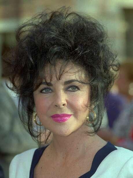 This is a 1992 photo of actress Elizabeth Taylor in Los Angeles. (AP Photo/ Kevork Djansezian) Photo: Kevork Djansezian / AP /Beaumont