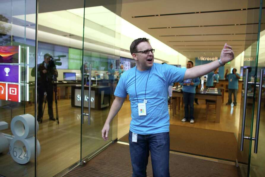 Customers are ushered into the store as Microsoft's new Surface tablet computer is released on Frida