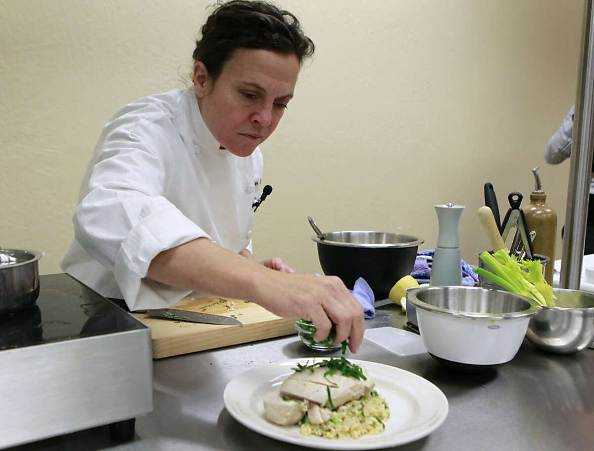 Chef Traci Des Jardins prepares poached chicken breast with a brown rice salad during a cooking demonstration at the Community Wellness Center's new kitchen at SF General Hospital in San Francisco, Calif. on Friday, Oct. 26, 2012.