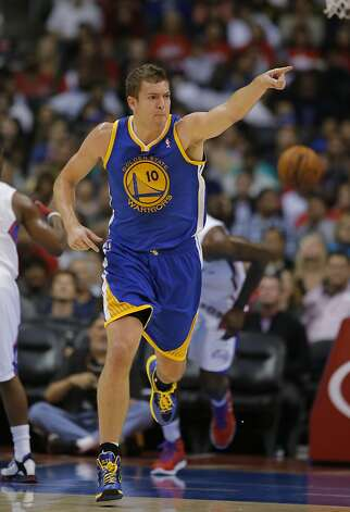 David Lee and his Warriors teammates have set the playoffs as a goal, even if the experts think that is unlikely to happen. Photo: Jae Hong, Associated Press