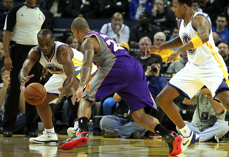 Carl Landry (left), stripping the ball from Phoenix's Shannon Brown, gives the Warriors another low-post scorer and rebounder in the frontcourt. Photo: Lance Iversen, The Chronicle