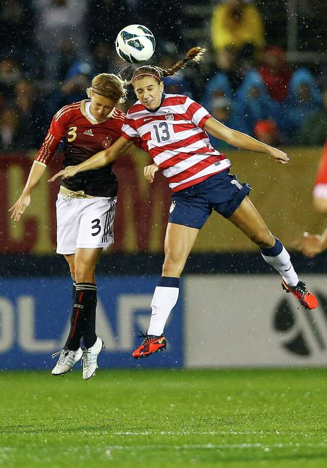 EAST HARTFORD, CT - OCTOBER 23: Alex Morgan #13 of the United States goes up for a header against Saskia Burtusiak #3 of Germany during the game on October 23, 2012 at Rentschler Field in East Hartford, Connecticut.  (Photo by Jared Wickerham/Getty Images)  *** BESTPIX *** Photo: Jared Wickerham, Getty Images / Getty Images North America