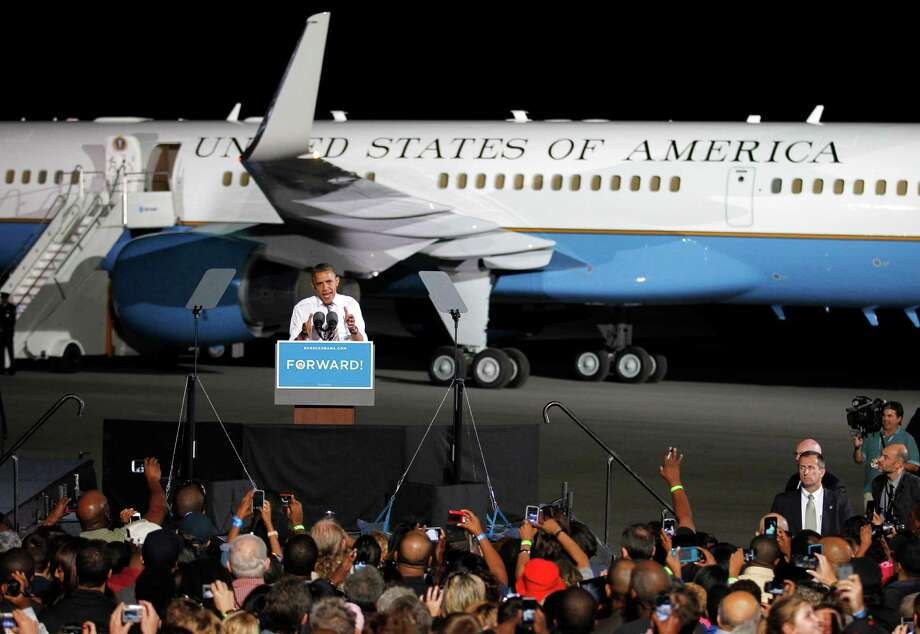 FILE - This Oct. 25, 2012 file photo shows President Barack Obama speaks in front of Air Force One at a campaign event at Burke Lakefront Airport in Cleveland. President Barack Obama's and Mitt Romney's meticulously arranged travel schedules, a crucial element of their final-stretch strategies, could be upended in the last full week before Election Day by a super storm barreling toward some battleground states. (AP Photo/Tony Dejak, File) Photo: Tony Dejak, STF / AP