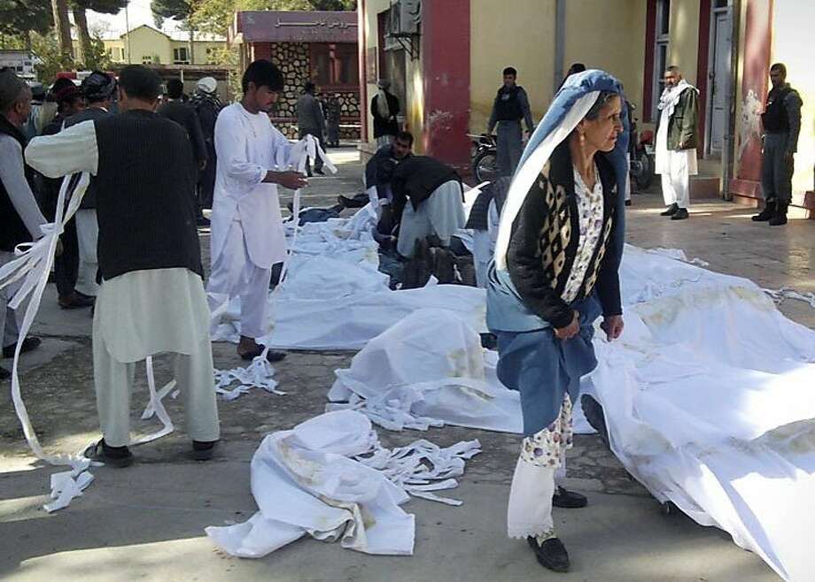 Bodies of suicide attack victims in a hospital courtyard in Maymana, Faryab province, northern Afghanistan. Photo: Qawtbuddin Khan, Associated Press
