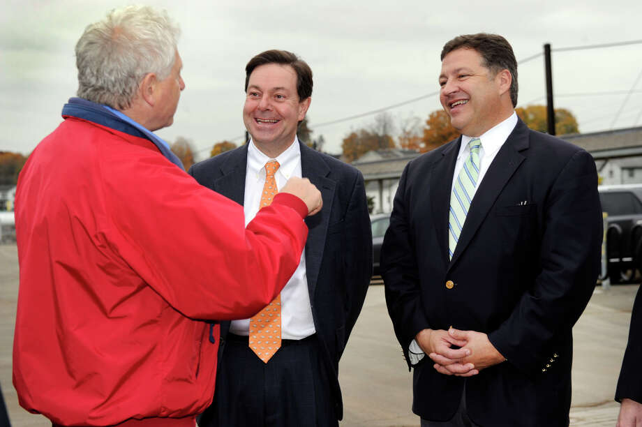 Danbury Fire Chief Geoff Herald, left, jokes with state Sen. Andrew Roraback, center, and U.S. Rep. Bill Shuster of Pennsylvania Friday, Oct. 26, 2012 at the Danbury railroad station. Shuster, who could be the next chairman of the transportation committee, was in Danbury to support Roraback, who is running for Congress. Photo: Carol Kaliff