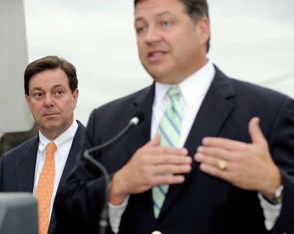 State Sen. Andrew Roraback, left, listens as U.S. Rep. Bill Shuster of Pennsylvania speaks in support of Roraback's bid for election to congress in the 5th District. Shuster, who could be the next chairman of the transportation committee, was at the Danbury railroad station to talk about future rail service in the area, Friday, Oct. 26, 2012. Photo: Carol Kaliff