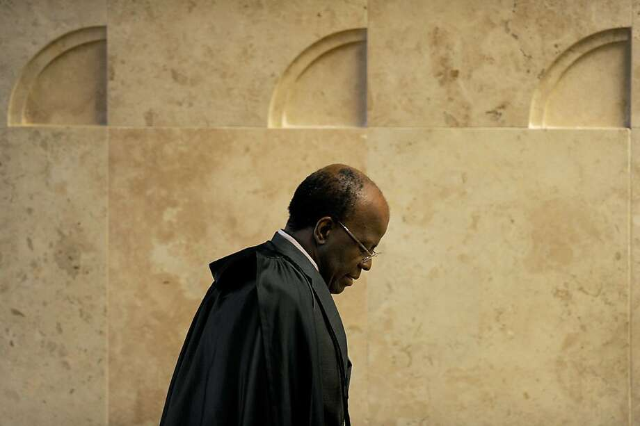 "Judge of the Supreme Court Joaquim Barbosa during the ""mensalao"" trial at the Supreme  Court building in Brasilia on October 10, 2012. Barbosa, 58, the tough justice overseeing Brazil's high-profile corruption trial, was officially nominated president of Brazil's Supreme Court, the first black to assume the post. Photo: Evaristo Sa, AFP/Getty Images"