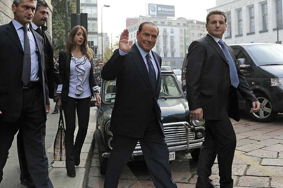 Former Italian Premier Silvio Berlusconi salutes as he arrives for a court hearing in Milan, Italy, Friday, Oct. 19, 2012. Berlusconi has denied in court having had sex with an underage Moroccan girl, or ever paying for sex with any guest at his villa near Milan, and insisted that no gathering of a sexual nature took place at his residence. Berlusconi made the remarks during a rare appearance at his ongoing trial on charges of having paid for sex with teenager Karima el-Mahroug and using his influence to cover it up. Photo: Gian Mattia D'Alberto, Associated Press