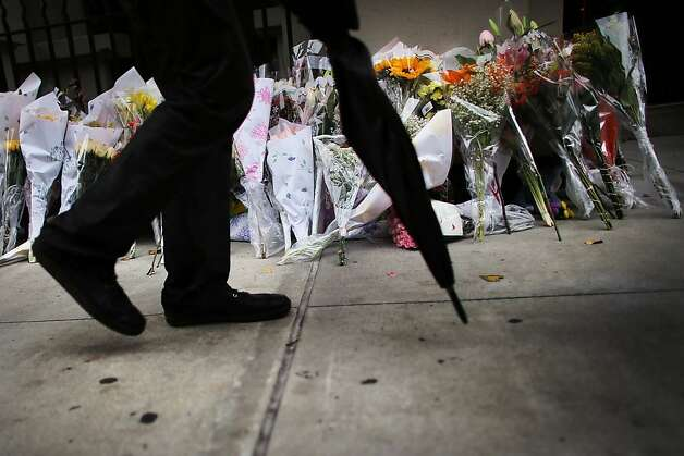 Flowers lay in front of the building where two children were stabbed to death. Photo: Spencer Platt, Getty Images