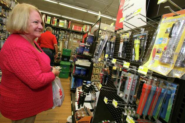 Susan Magee checks the selection of batteries and flashlights at Feinsod Hardware Friday, Oct. 26, 2012, in preparation for Monday's possible storm. Photo: David Ames / Greenwich Time
