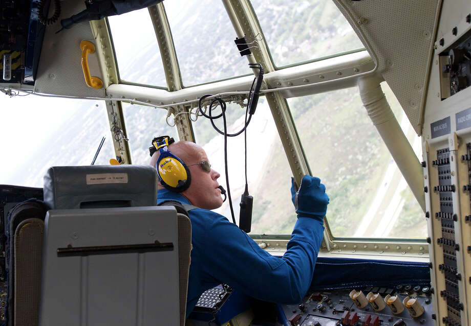 Marine Blue Angel Captain John Hecker looks out the cockpit window during a flight aboard the Blue Angel's Fat Albert C130 airplane at Ellington Field Friday, Oct. 26, 2012, in Houston. Photo: Cody Duty, Houston Chronicle / © 2012 Houston Chronicle